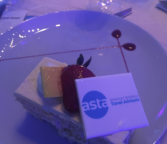 cake with asta logo on it