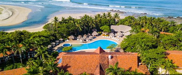 view of pool and ocean at occidental tamarindo